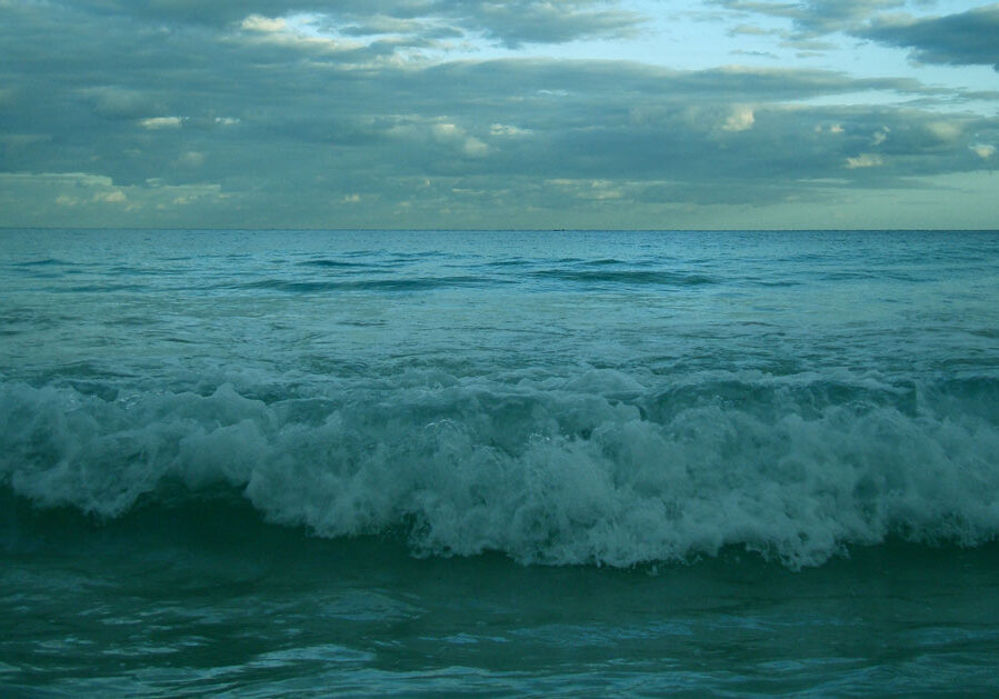 Waves crashing on the beach in the evening